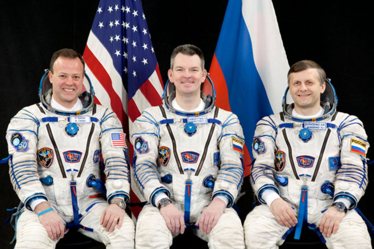 NASA astronaut Ron Garan, left, and Russian cosmonauts Alexander Samokutyaevn, center, and Andrey Borisenko pose forwhile clad in Russian Sokol spacesuits.The crew's launch on the Soyuz TMA-21 capsule to visit the International Space Station for Expedition 27 has been delayed.