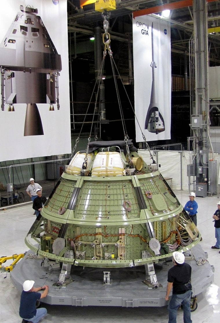 Lockheed Martin engineers at NASA's Michoud Assembly Facility in New Orleans inspect the Orion space capsule ground test structure before shipping on Feb. 10. The crew-carrying spacecraft prototype will undergo rigorous testing to verify it can withstand the harsh environments of a deep-space mission.