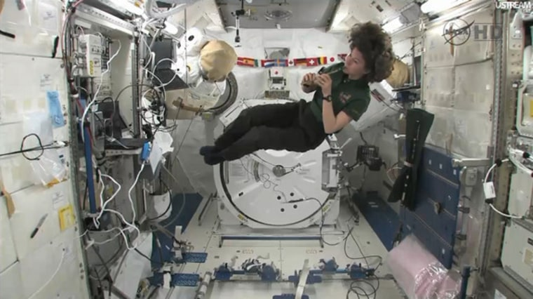 Irish astronaut Cady Coleman plays a pennywhistle on loan from the Irish band the Chieftains while flying in the Kibo lab on the International Space Station Thursday on St. Patrick's Day.