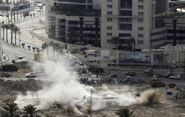 Image: The Pearl Square statue is tore down in Manama