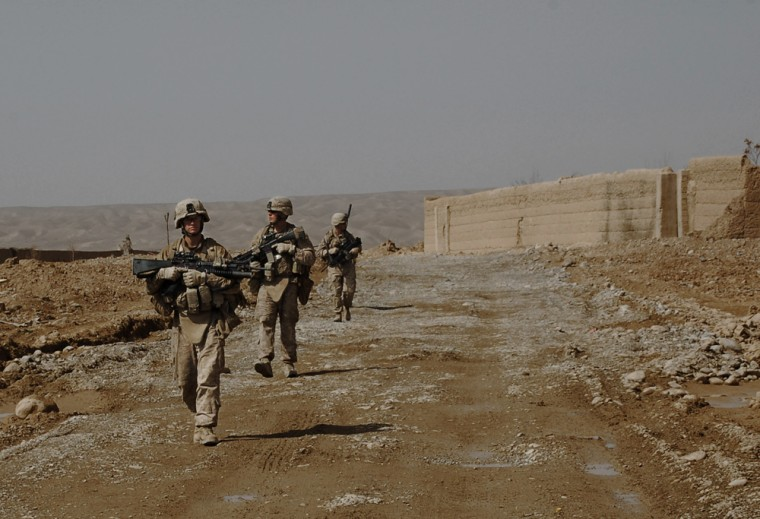 Image: Marines patrol down the main road in the Wishtan area of Sangin district southern Helmand province of Afghanistan