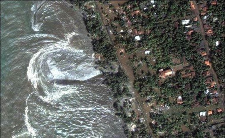 During the Indian Ocean tsunami of 2004, water rushes ashore in Sri Lanka. The tsunami killed more than 220,000 people around the world and prompted U.S. officials to focus on tsunami preparedness closer to home.
