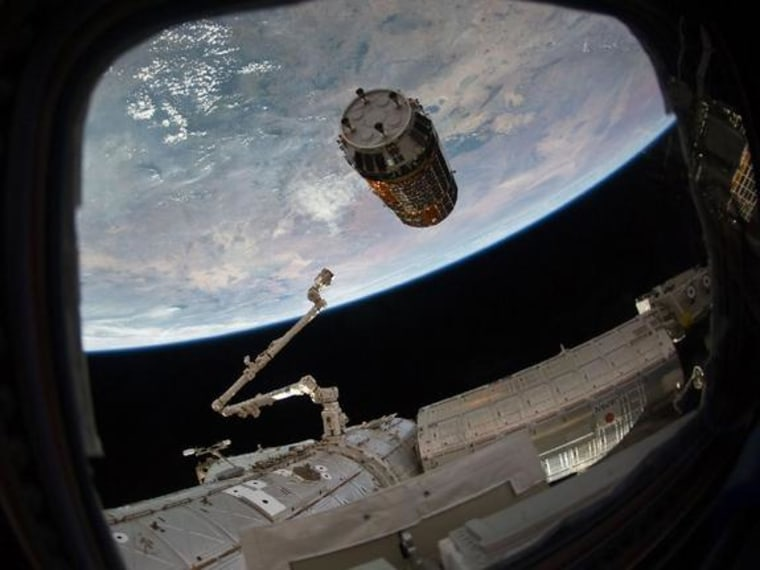 Japan's HTV-2 robotic cargo ship is seen just before astronauts grapple it on Jan. 27. The spacecraft is one of several robotic cargo ships that ferry supplies to the space station.
