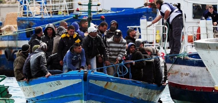 Image: Would-be immigrants in a boat are helped