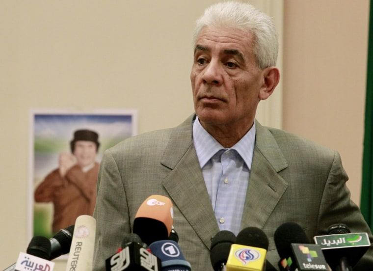 Image: File photo off Libya's Foreign Minister Moussa Koussa holding a news conference in Tripoli