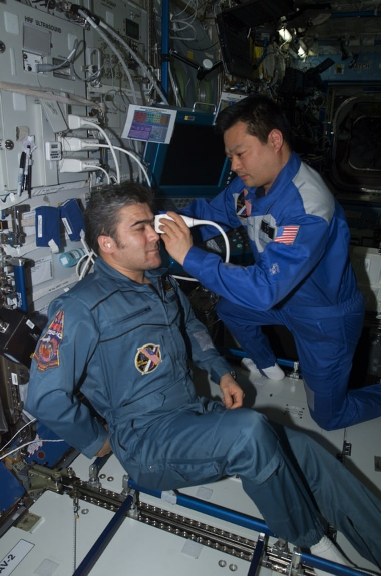Astronaut Leroy Chiao performs an ultrasound examination of the eye on cosmonaut Salizhan Sharipov aboard the International Space Station. NASA helped turn the station's ultrasound machine into an all-purpose diagnostic imager with a direct line to doctors on Earth. The technology could soon help diagnose sick people in isolated communities around the world.