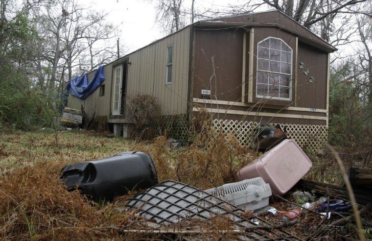 Image: Trash sits outside an abandoned trailer in Cleveland, Texas where authorities say an 11-year-old girl was sexually assaulted