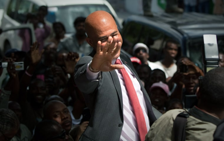 "Image: Musician Michel ""Sweet Micky"" Martelly  greets his supporters"