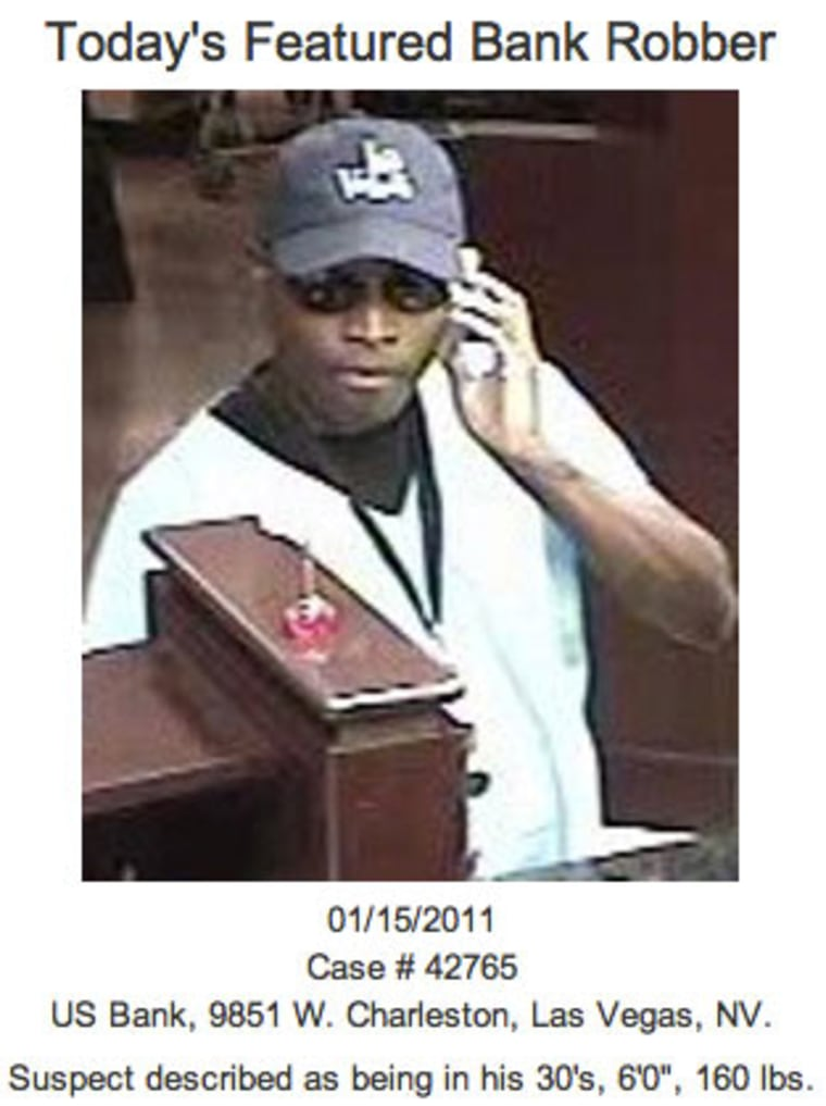 Image: Security camera shot of an alleged bank robber with information about suspect