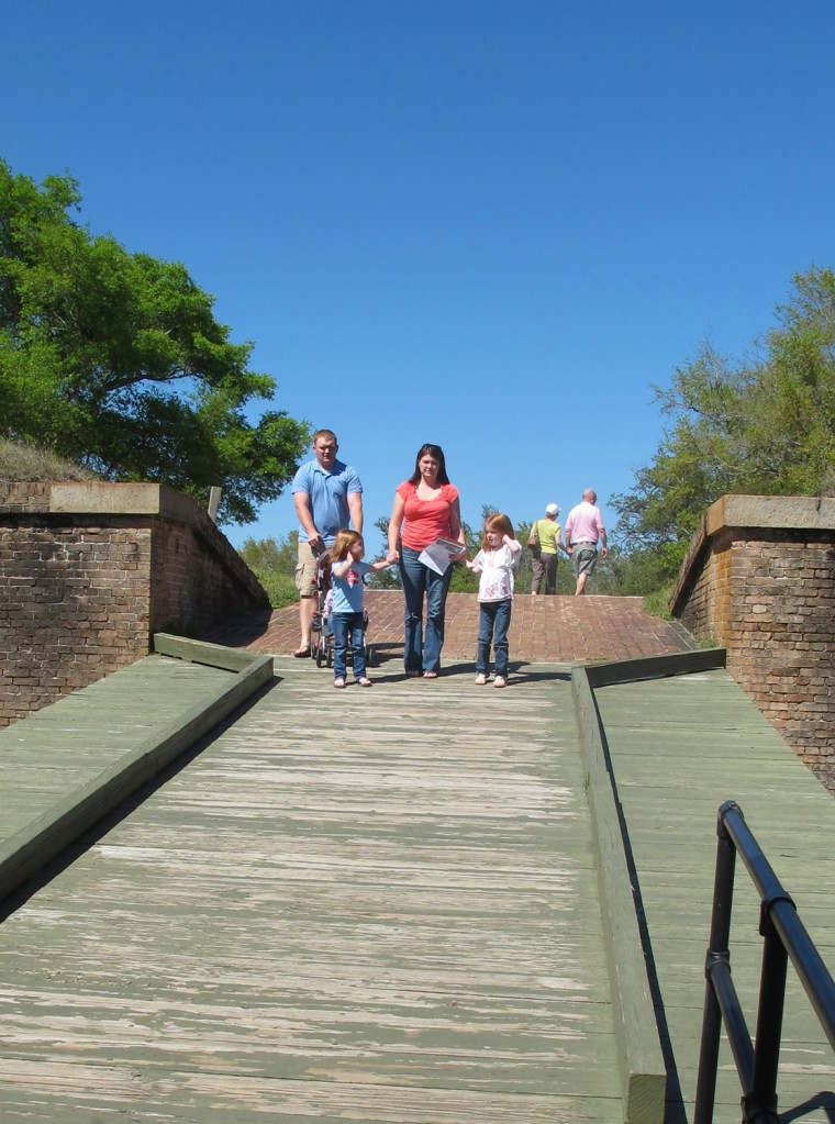 Image: Tourists cross a bridge to enter Fort Barrancas at Gulf Islands National Seashore near Pensacola Beach