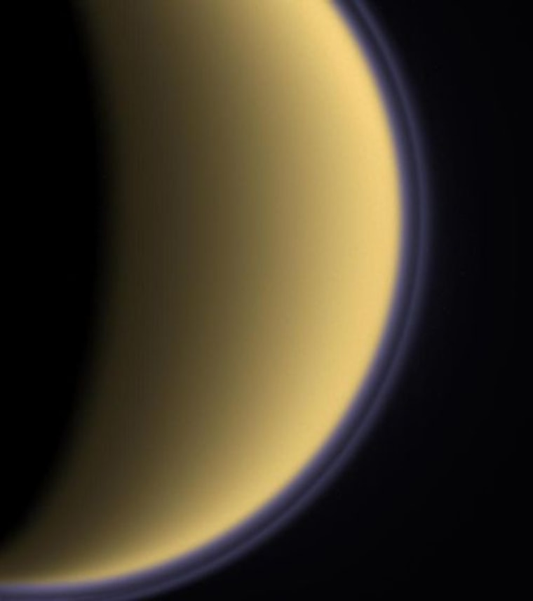 The atmosphere of Titan can be seen on the Saturn moon's limb in this stunning view from NASA's Cassini spacecraft.