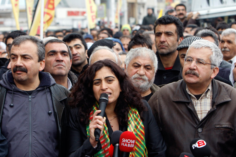 Image: BDP Parliamentarians Sebahat Tuncel (C) and Ufuk Uras (R) attend a protest against a High Election Board decision in central Istanbul on April 19
