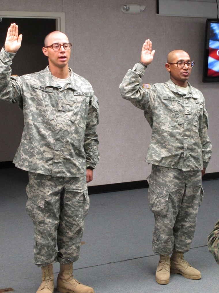 Image: Army Pvt. Jovany Mira, of Colombia, left, and Pfc. Shoumendra Nandy, of Bangladesh, take the oath to become U.S. citizens, at Fort Jackson, S.C.