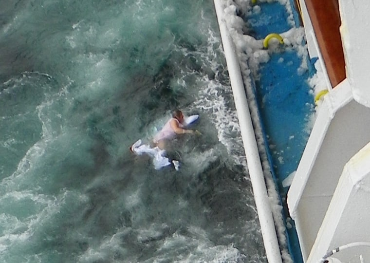 Image: Janet Richardson, 73, falls into the sea while being transferred to a rescue boat after being taken ill on board the Ocean Countess ship.