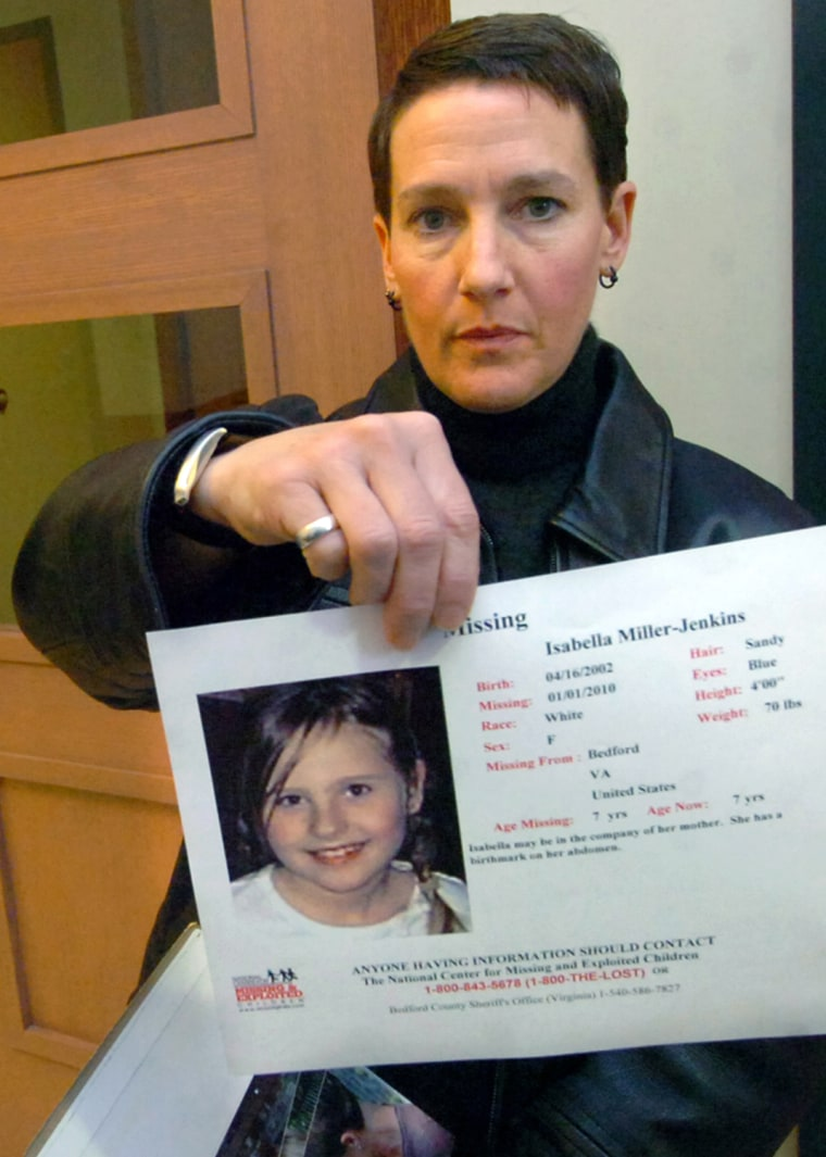 Image: Janet Jenkins hold a photo of her daughter, Isabella Miller.