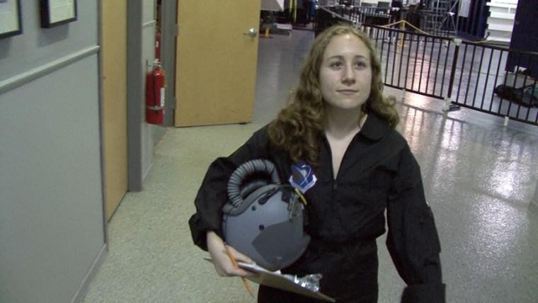 Image: Reporter walks toward hypobaric chamber