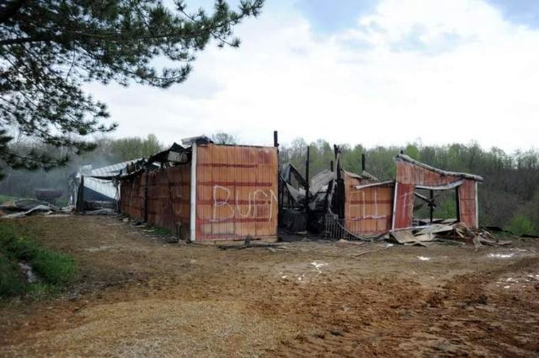Image: The remains of Brent Whitehouse's barn in McConnelsville smolder