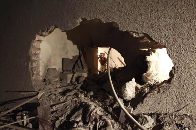 Image: Damage Damage which the Libyan government said was caused by a coalition air strike is seen at the house of Saif Al-Arab Gaddafi in Tripoli