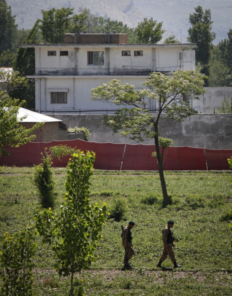 Image: Soldiers keep guard around a compound within which al Qaida leader Osama bin Laden was reportedly killed in Abbottabad
