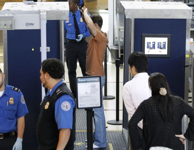 Image: A man is screened with a backscatter x-ray machine at a TSA security checkpoint iat Los Angeles International Airport