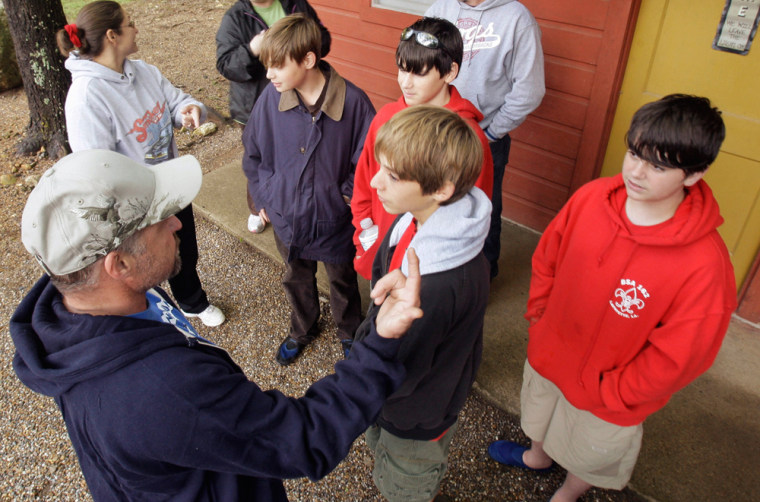 Image: Parent Gene Josey, left, talks with Boy Scouts Ian Fuselier, second from left, Dylan Docte, top center, Stephen Miller, far right, and Josey's son Caleb Stutes at a campground near Langley, Ark., after the Scouts were rescued