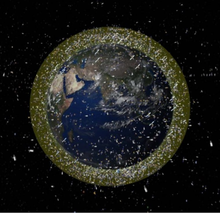 An illustration depicts the density of space junk around Earth in low-Earth orbit.