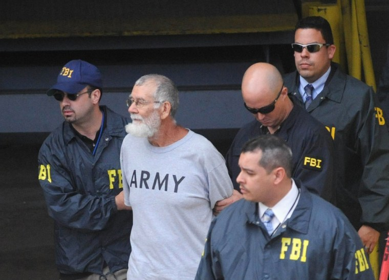 Image: Norberto Gonzalez Claudio is escorted by FBI agents after his court appearance in San Juan, Puerto Rico