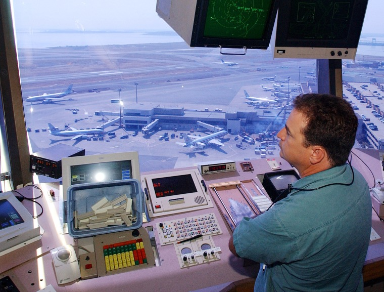 Image: Matt McCluskey directs air and runway traffic