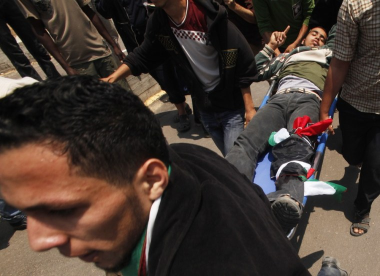 Palestinian is carried after he was shot by Israeli fire during clashes near Erez crossing between Israel and northern Gaza Strip