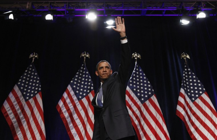 Image: U.S. President Barack Obama waves to supporters at a Democratic National Committee event in Washington