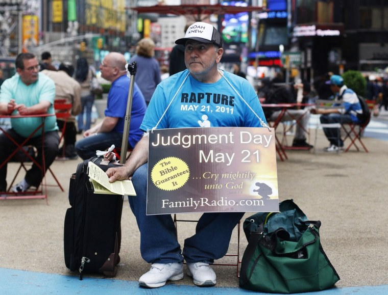 Image: A volunteer from the U.S. religious group Family Radio hands out pamphlets with warnings of an impending Judgment Day at Times Square in New York