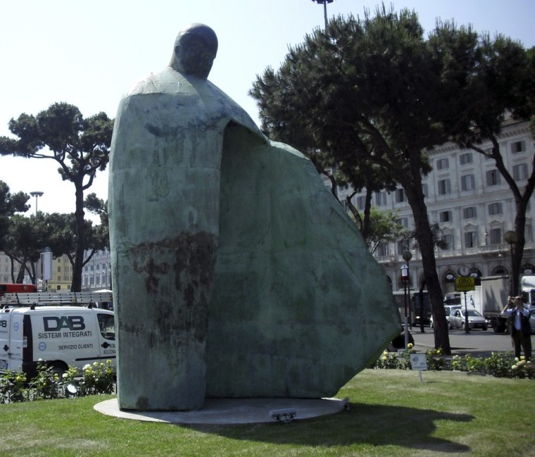 Image: A giant bronze sculpture portraying Pope John Paul II is displayed outside Rome's Termini train station.