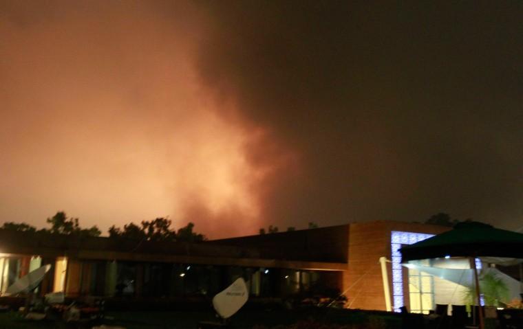 Image: Smoke rises above buildings in Tripoli
