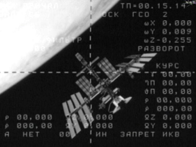 Engineering video from a departing Russian Soyuz craft shows the International Space Station with the shuttle Endeavour docked to it at lower right, and Earth's bright disk at upper left. Thiswas the first time such a scene has been recorded from space. Space officials plan to release high-definition, full-color versions of the scene later.