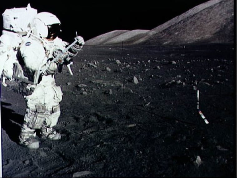 Astronaut Harrison Schmitt collects lunar rake samples during an Apollo 17 moonwalk in December 1973. He is the last man to set foot on the moon.