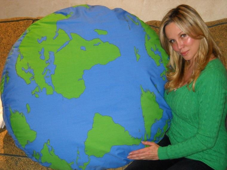 Kari Whitman poses with circular Greener Pup Earth bed.