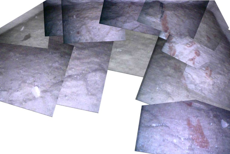 A composite of images taken by a robot of the floor of the Great Pyramid is shown. Red hieroglyphs are visible.