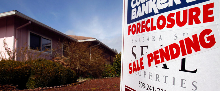 Image: A foreclosed house with sale pending sign is shown in Tigard, Ore.