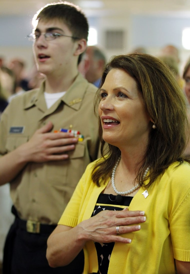 Image: U.S. Congresswoman and likely Republican presidential candidate Michele Bachmann sings 'God Bless America