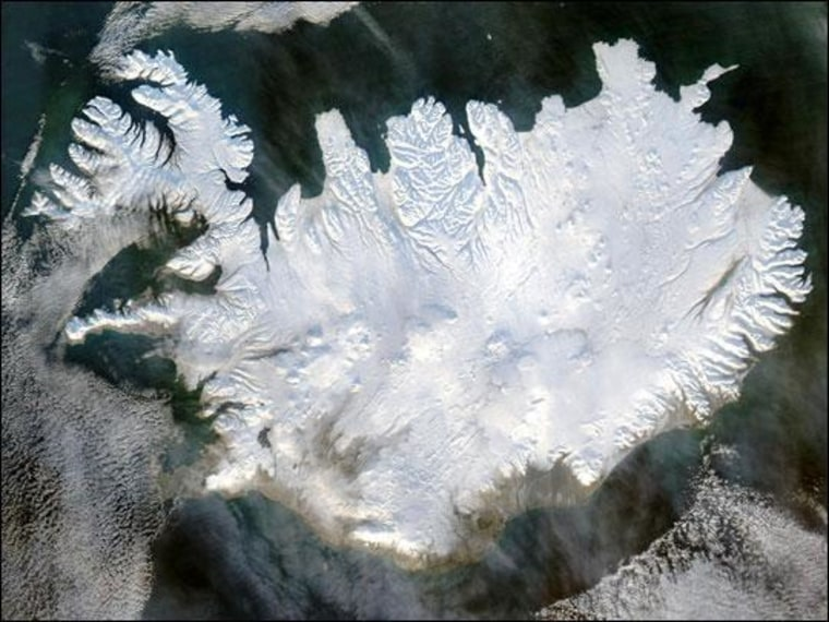 Image: The volcanic island of Iceland covered in snow.