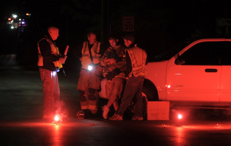 Members of Oriskany Falls fire department block access to Knoxboro Road, Tuesday, June 7, in Knoxboro, N.Y., after a fatal standoff between deputies and a male gunman which resulted in a deputy and the suspect being shot.
