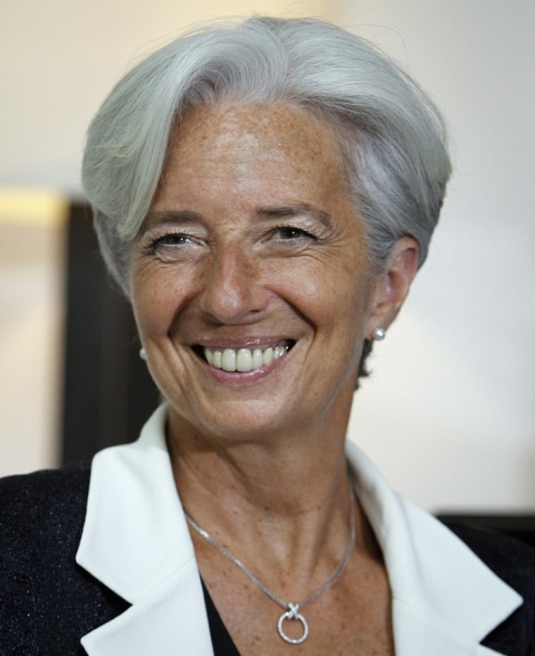 Image: French Finance Minister Christine Lagarde smiles as she takes questions during a news conference in New Delhi