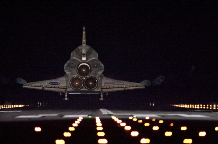Runway lights help lead space shuttle Endeavour, seen here from behind, home to NASA's Kennedy Space Center in Florida. Endeavour landed for the final time on the Shuttle Landing Facility's Runway 15, on June 1, marking the 24th night landing of NASA's Space Shuttle Program.