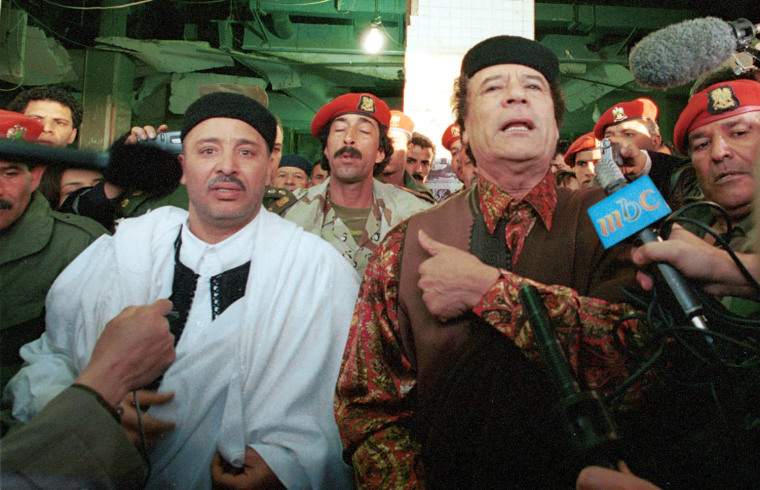 Lockerbie bombing defendant Al-Amin Khalifa Fhimah speaks to the media with Libyan leader Moammar Gadhafi after being acquitted.