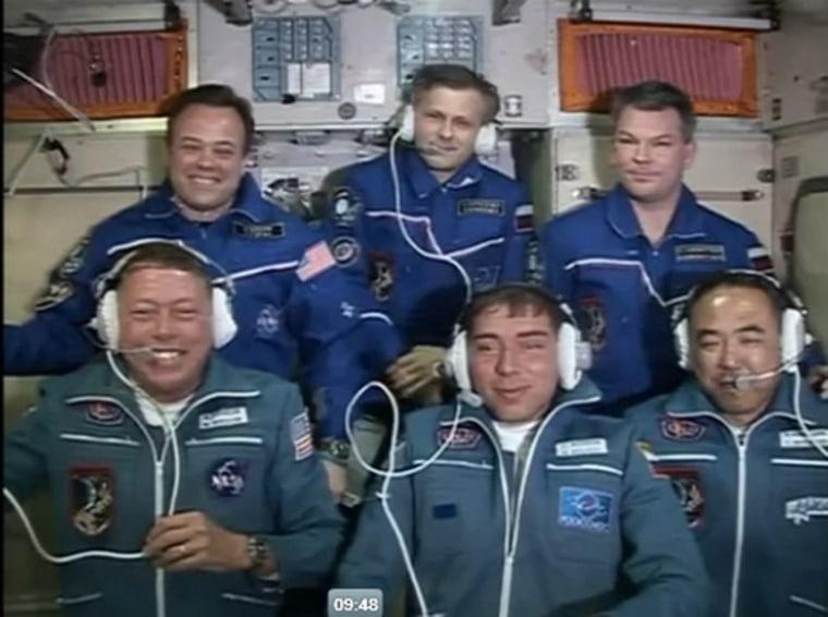 Screenshot: six astronauts on space station