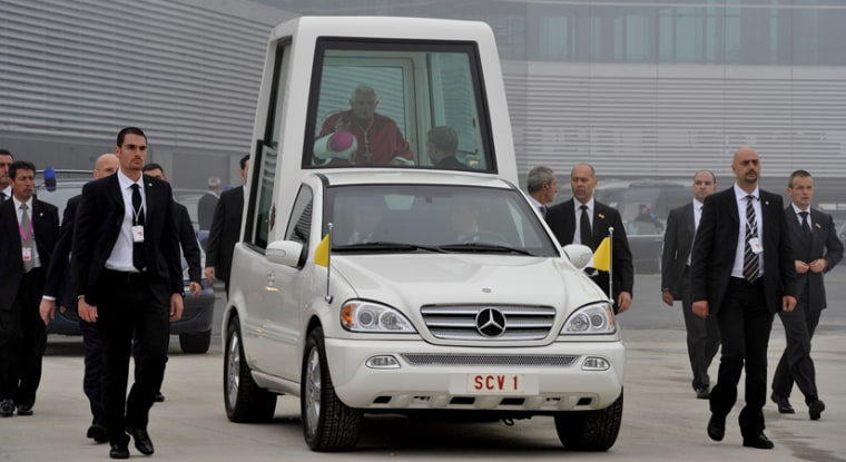 Pope Benedict XVI waves from the popemobile as he arrives at the Lavacolla airport in Santiago de Compostela, Spain, in this file photo.
