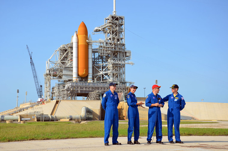 NASA's final space shuttle crew took part in a press conference on Wednesday while standing behind their spacecraft, Atlantis, and Kennedy Space Center's Launch Pad 39A. From left to right are STS-135 mission specialists Rex Walheim, Sandra Magnus, pilot Doug Hurley and commander Chris Ferguson.