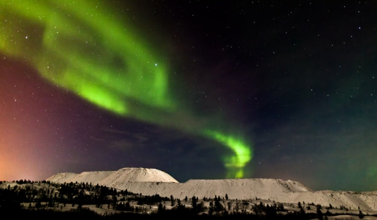 "Norwegian photographer and skywatcher Terje Sorgjerd created an amazing video of the March 2011 auroras, or northern lights, which appear in this still from his project, titled ""The Aurora."""