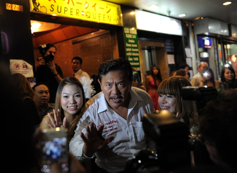 Image: Former massage parlour tycoon-turned-politician and candidate for the Rak Thailand party Chuvit Kamolvisit