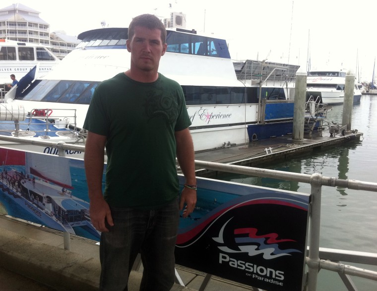 Ian Cole had to swim to another boat after he was left behind on a Great Barrier Reef snorkelling trip.